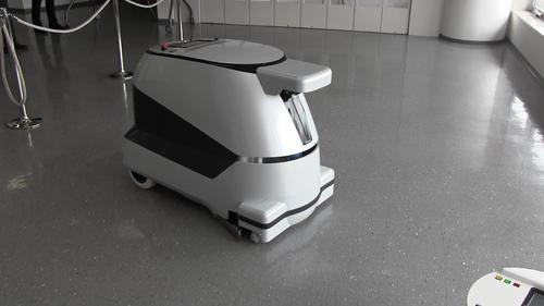 An industrial cleaning robot prototype developed by Sharp.  It operates in a pre-programmed fixed area, avoiding obstacles and people.