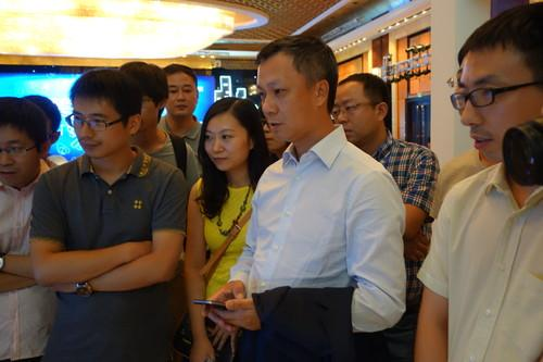 Alibaba's CEO tries out the company's upcoming set-top box product.