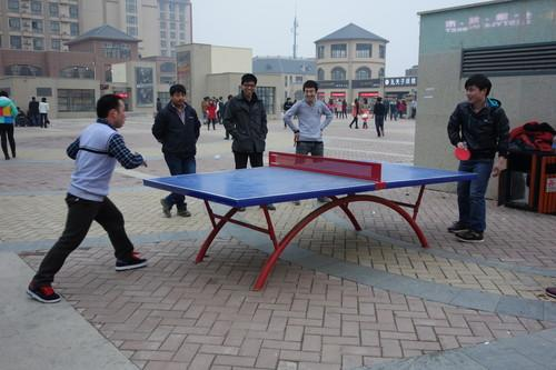 Foxconn workers play ping-pong.