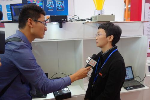 Fudan University Professor Chi Nan being interviewed.