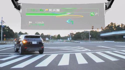 Pioneer's new car navigation system includes a heads up display that mounts on the ceiling and uses a laser to project images that appear to hover over the road.