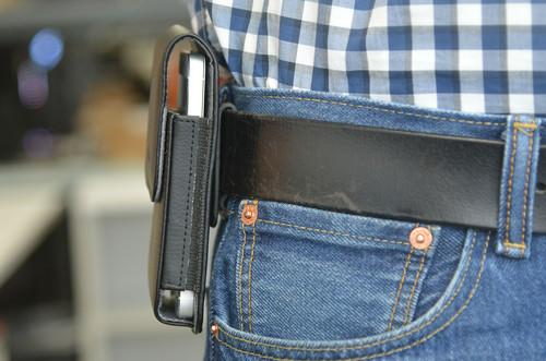 A cellphone holster holding an Apple iPhone 5s.