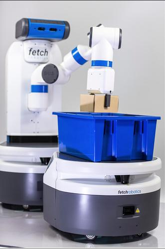 Fetch Robotics' new Fetch robot (rear) can autonomously grab inventory from shelves and place it into the Freight mobile bin robot (front). The machines are designed to work in warehouses filling e-commerce orders.