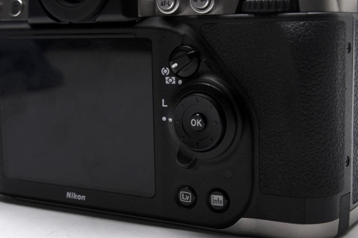 The rear of the camera has more common features for navigating the system menu and playback, though you do also get a tactile metering control.