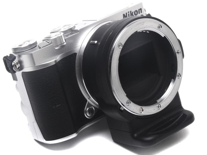 With the FT1 lens mount adapter, which costs a lot of money (we saw it for $379 at Digital Camera Warehouse at the time of writing).