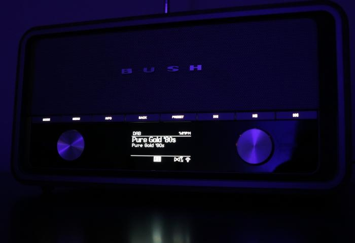 The screen displaying digital radio content at night.
