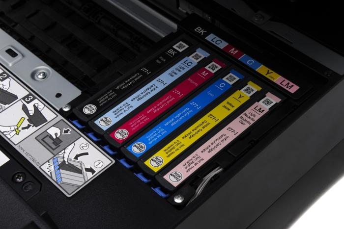 The ink cartridges are easy to access and replace.