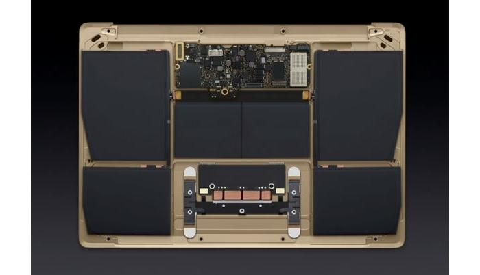 A highly integrated design, dominated by batteries, with the motherboard and touchpad being the only other parts.
