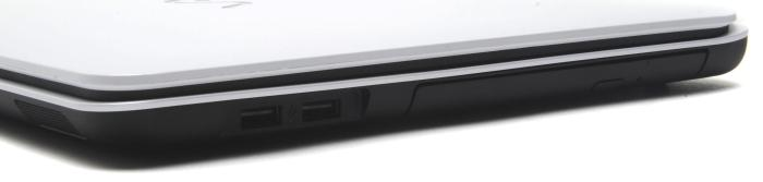 The right side holds the DVD burner and two USB 2.0 ports. You can see the speakers are at the front, and the slot-loading SD card slot is also at the front.